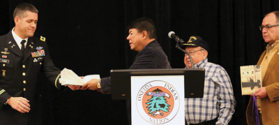 Col. Bryan Laske receives a friendship feather from Nation Representative Ray Halbritter during the annual Veterans Recognition Ceremony.  Council members Keller George (Wolf Clan), USN, Ret., and Brian Patterson (Bear Clan) also attended.