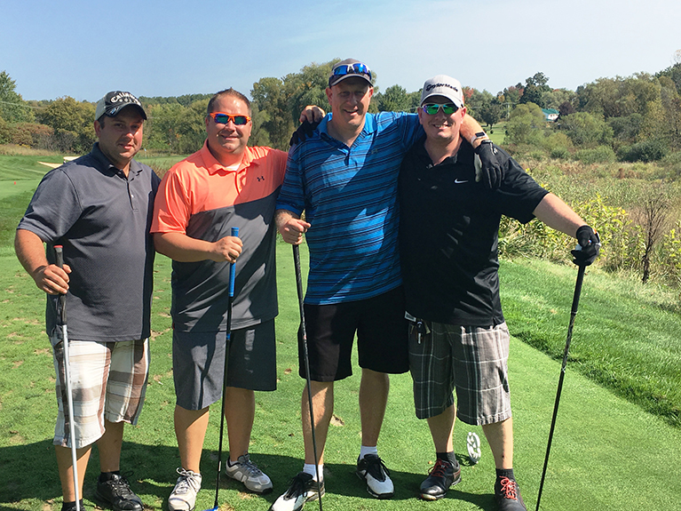Employees tee off at TS courses for a day of golf